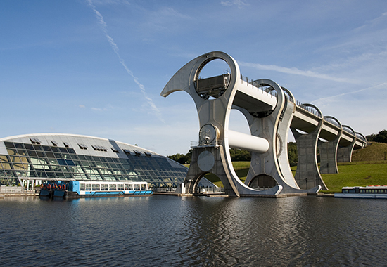 The Falkirk Wheel, named after the nearby town of Falkirk in Central Scotland, is a rotating boat lift connecting the Forth and Clyde Canal with the Union Canal. The two canals were previously connected by a series of 11 locks, but by the 1930s these had fallen into disuse, were filled in and the land built upon.
