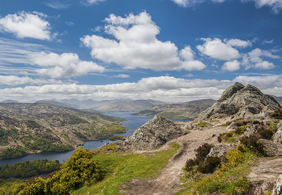 Looking over Loch Katrine in The Trossachs National Park in the Scottish Highlands from the summit of Ben A'an