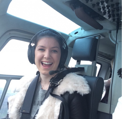 Lucy flying a helicopter