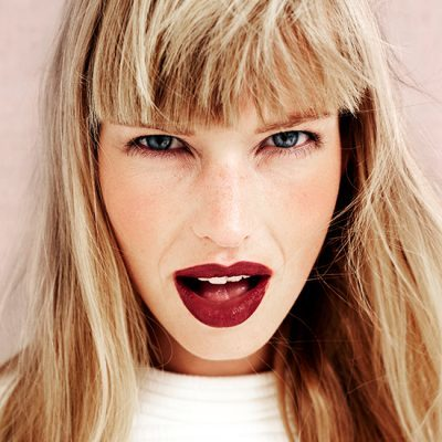 Pretty blond woman with red lipstick, close up