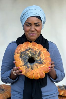 LONDON, ENGLAND - MAY 17: Nadiya Hussain poses with a Great Fire of London inspired bake during a photocall opening a new experience at The London Dungeon, which marks the 350th anniversary of the Great Fire of London, on May 17, 2016 in London, England. (Photo by Ben A. Pruchnie/Getty Images)