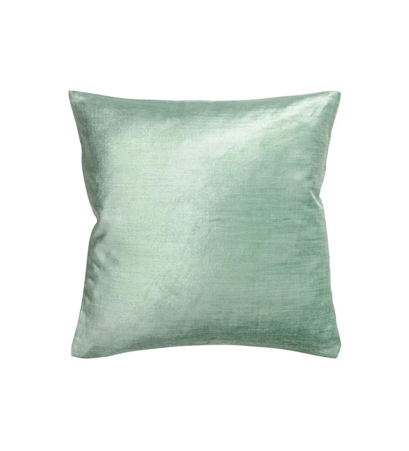 Pale green H&M cushion