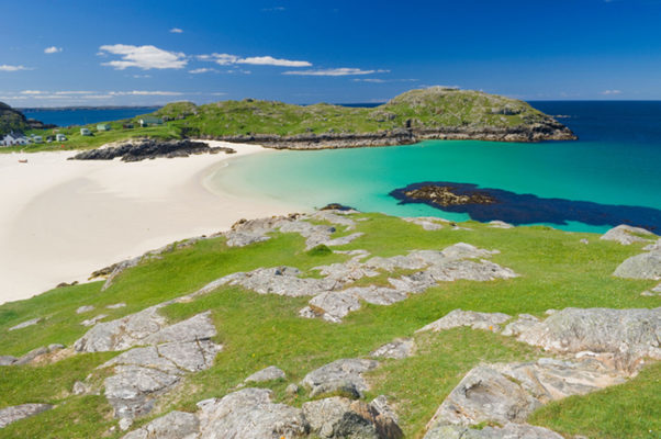 Beach at Achmelvich in the Scottish Highlands on a beautiful summers day. One of the best beaches in Scotland.