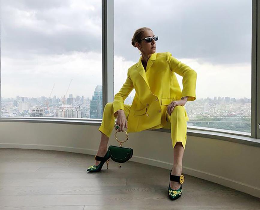 Celine Dion yellow suit