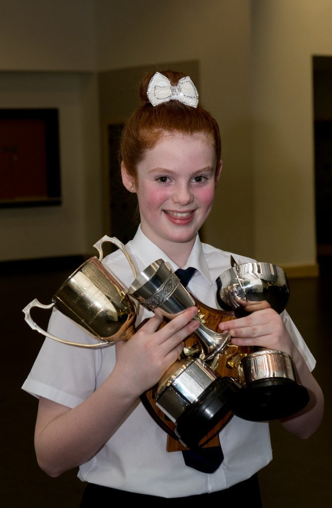 Laura Robertson with a haul of trophies from this year's festival.