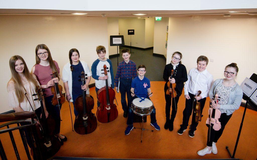 Lochaber music school fiddle group under 18.