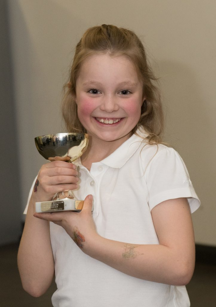 Young Fiona Austin with her award for Strings solo Juniors.