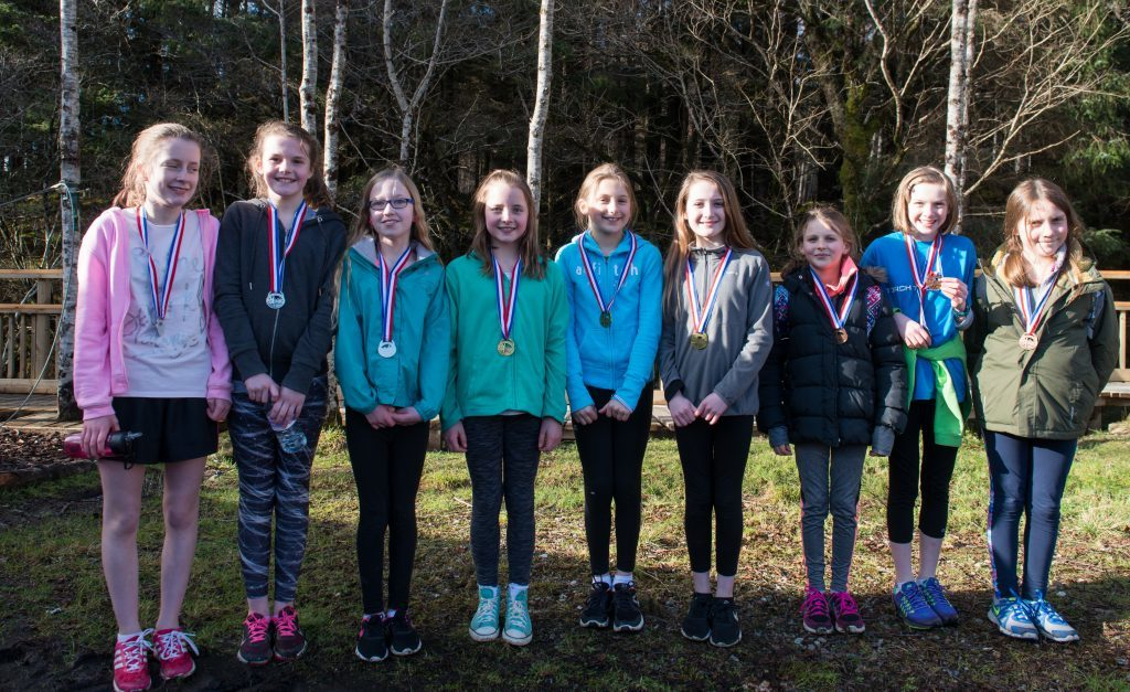 Girls' teams winners: Lundavra (second), Banavie (first)  and Strontian (third). Abrightside Photography.
