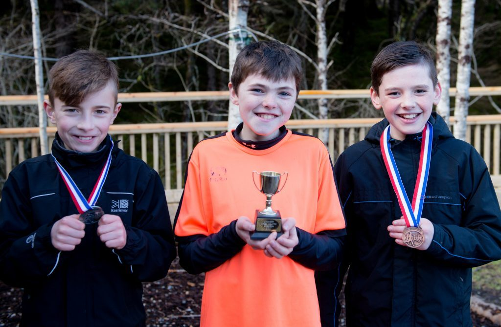 Boys' race winners: Brian Wilson from Caol (second), Martin Addison from Lundavra (first) and Kyle Nolan, also Caol (third). Abrightside Photography