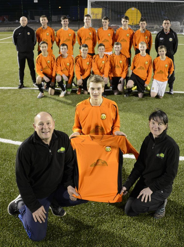 FORT U17 STRIPS 21/3/15 Davy Duncan and Helen Smith of Lochaber Embroidery and Printing (LEAP) presented new strips to Fort William FC U-17 team captain, Fraser Gray. Training for the team takes place every Friday evening from 6.30pm on the all weather pitch at Lochaber High School. PICTURE IAIN FERGUSON, THE WRITE IMAGE. F16football5noIF