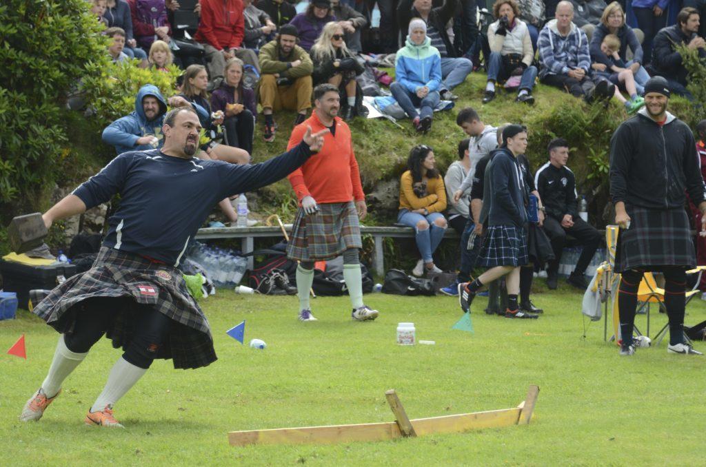 One 'heavy' puts his weight behind the throw. F33 Skye Games 03NO. Photo: Sara Bain.