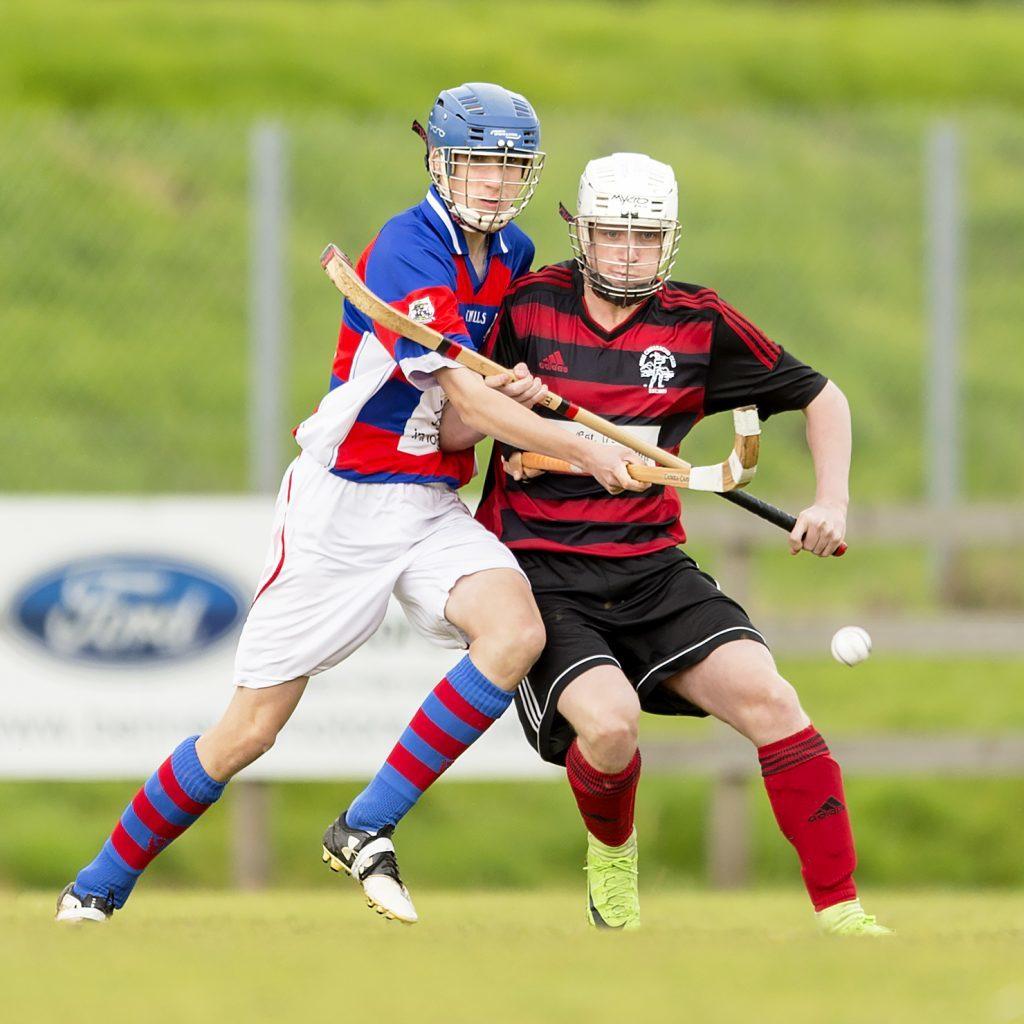 Lochside's Craig Easton holds off Kingussie's Liam Borthwick.