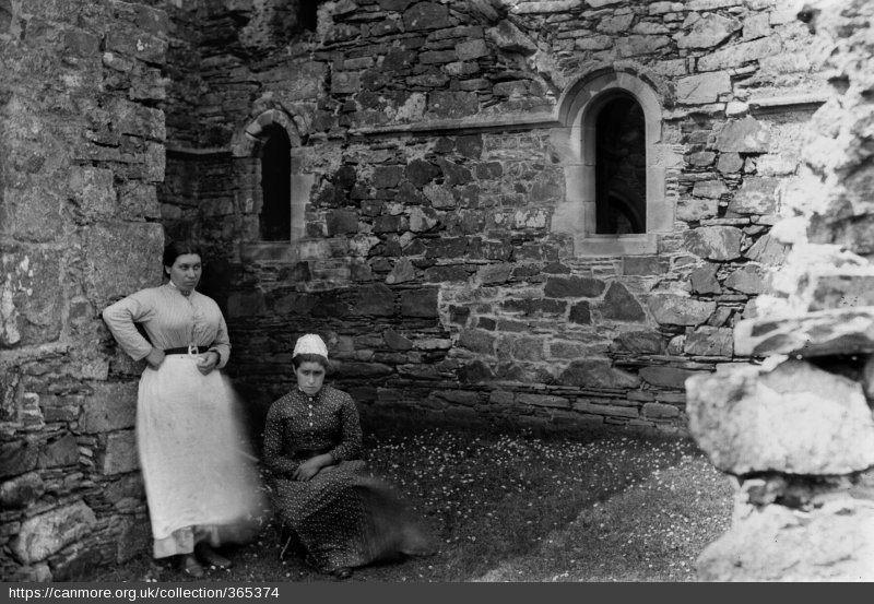 Two ladies in Iona Abbey's north transept. No date.