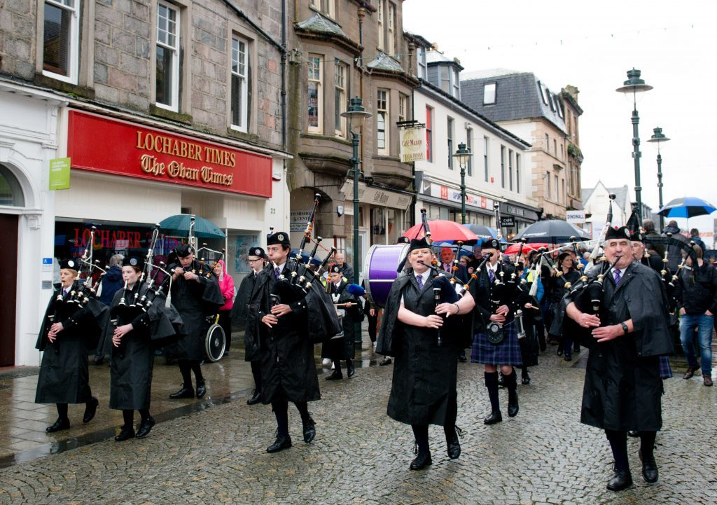 Led by Lochaber Pipe Band, the massed choir marched down the High Street towards the parade. Photograph: ABrightside Photography