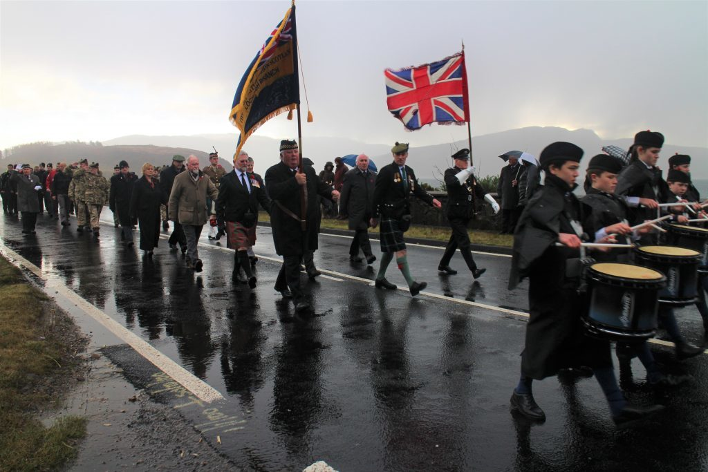 A large procession marched to the Lochalsh War Memorial on Sunday. IF F46 Remembrance Lochalsh 02.