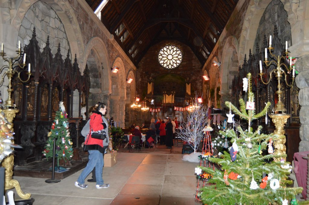 The kirk was filled with Christmas trees.