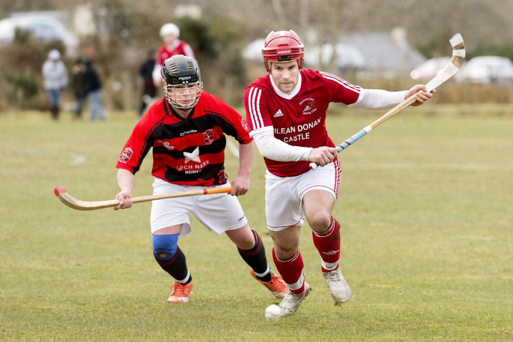 Kinlochshiel's Keith MacRae gets ahead of John Peteranna during the Kinlochshiel v Glenurquhart match.
