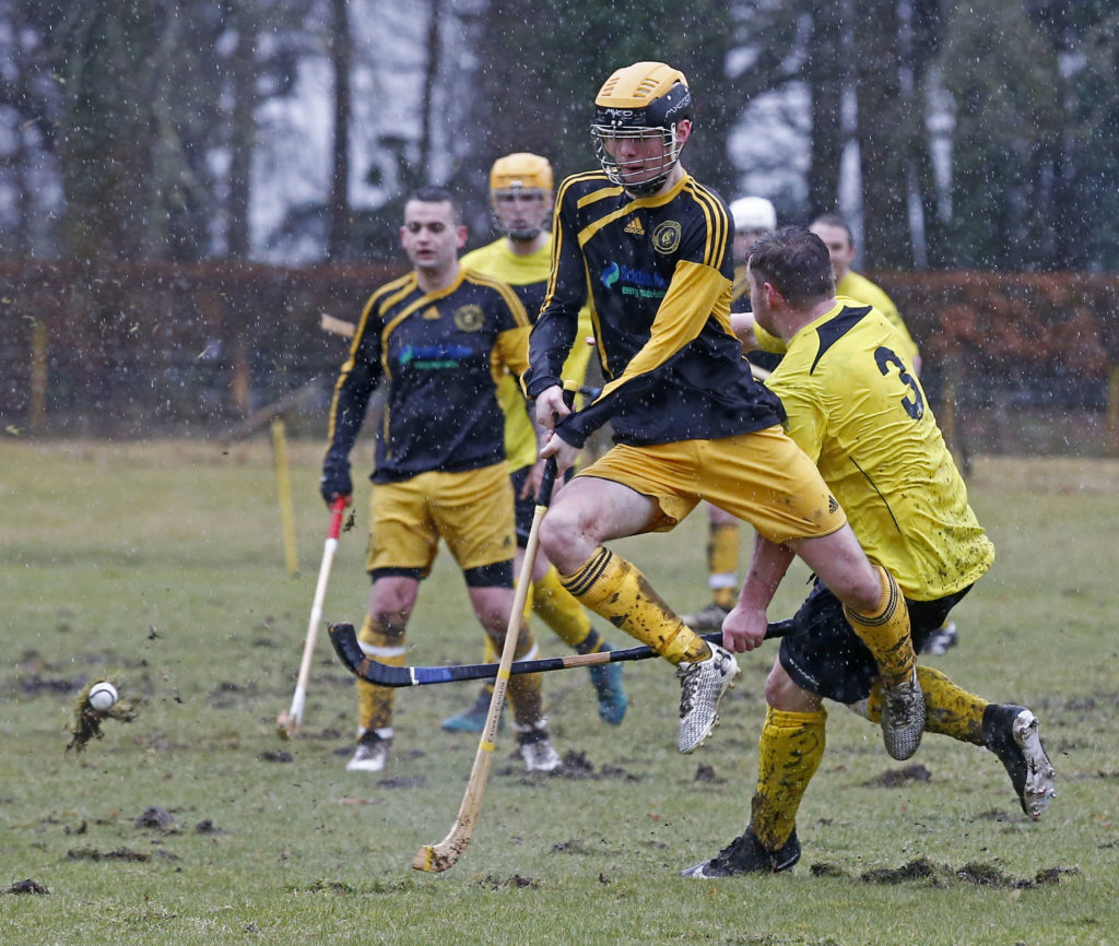 Mud, mud, glorious mud: Inveraray and Fort William played their National Division match at the Winteron in horrendous weather. Our photograph shows Inveraray's Fraser Watt jumping  over an attempted clearance from Fort William's Shaun Cruickshank. Photograph: Stephen Lawson.