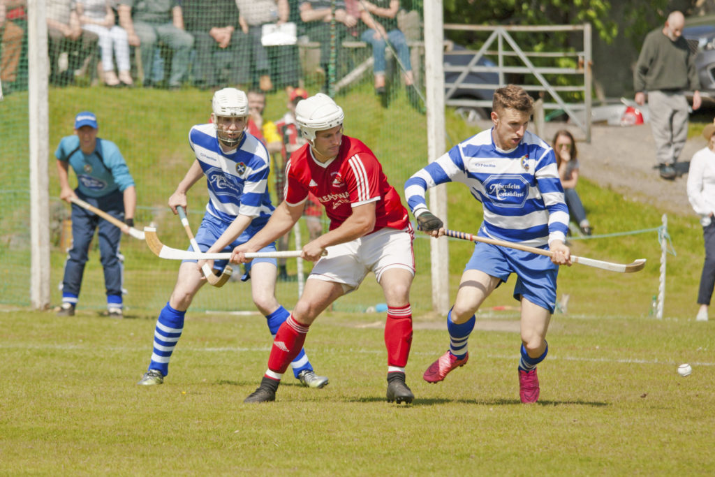 Action from the Marine Harvest Premierhship match between Kinlochshiel and Newtonmore which the Badenoch side won by the odd goal in three. Photo: Tina Marshall