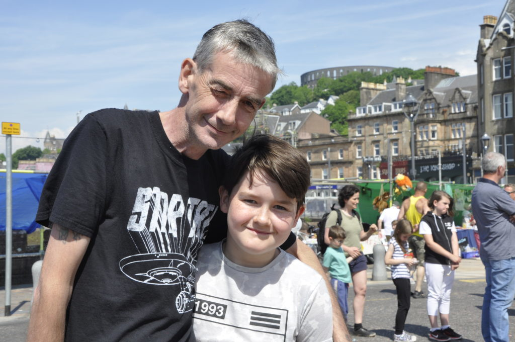 John Hutchison and his son Liam enjoying the good weather. 16_T23_CharitiesDay15