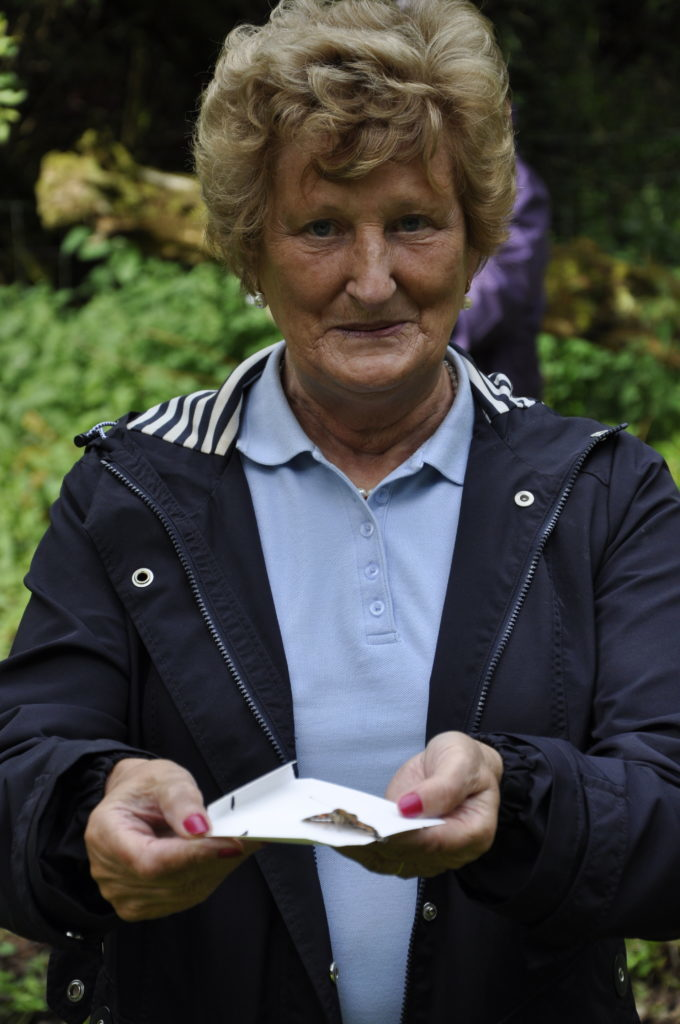 Retired Oban midwife, Betty MacIntyre, prepares to release her butterfly. 16_T25_Butteryflyrelease11