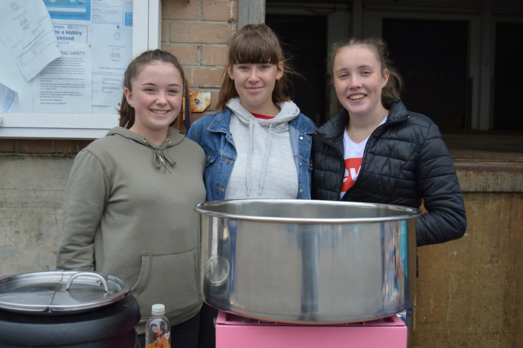 ​ Rhian Eddie, Faye Henderson and Jodie Gray were in charge of selling candyfloss and a big pot of Nancy Dunn's homemade Cullen skink. Photograph: Joanne Simms