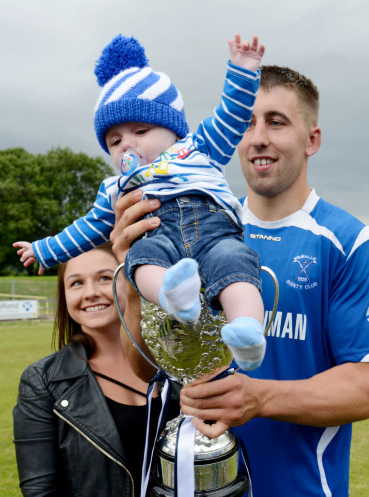 A big cheer from five-month-old Jack Macdonald as his dad, Liam, captained the Kilmallie side while he and mum Lesley watched. Picture Iain Ferguson, alba.photos