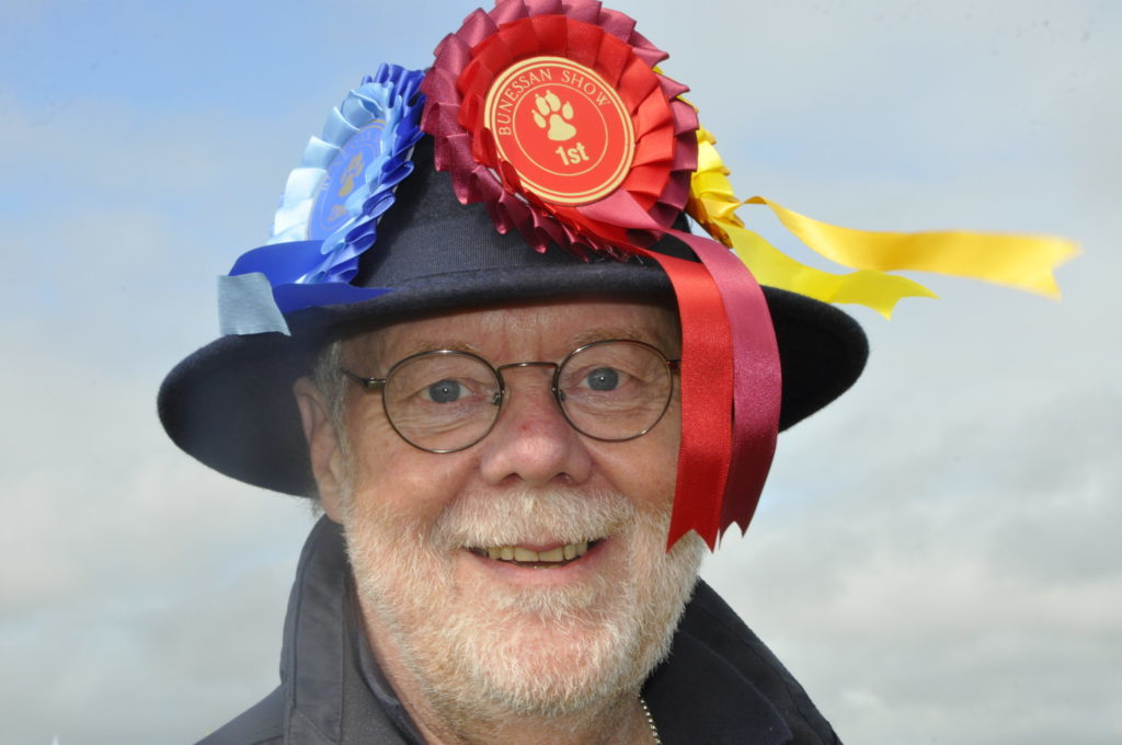 Another happy face at Bunessan Show was rosette hat man Roger Pendlebury