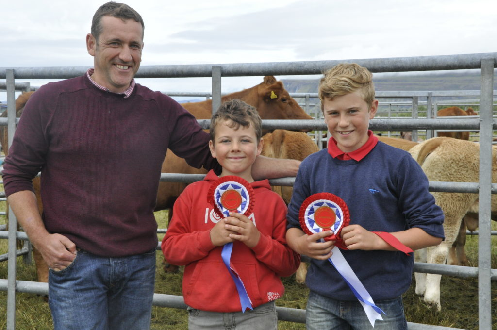 John MacInnes next to sons Cameron and Jamie from Iona with their champion cattle