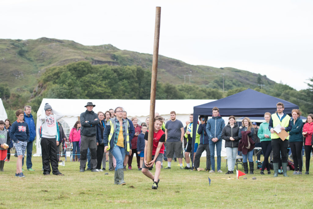A young visitor to the area has a go at tossing the caber. F32 MM Games 15