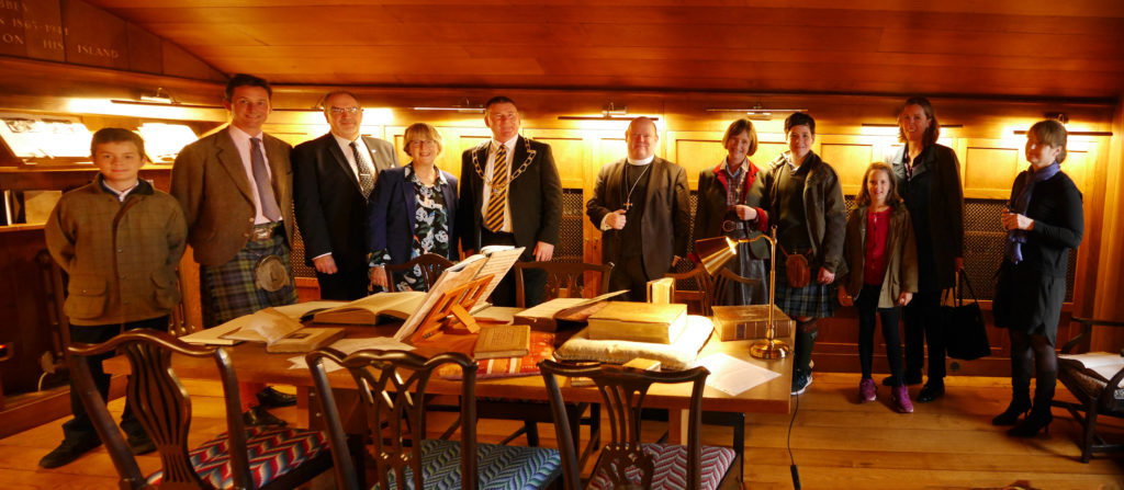 The Duke of Argyll and others celebrate the official opening of the new heritage collection at Iona Library.