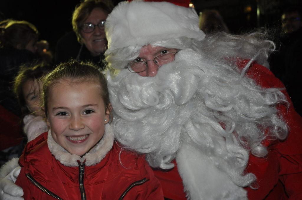 Sienna Lopez, seven, gets a selfie with Santa.