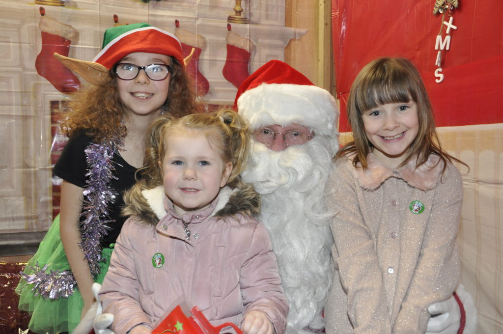 Freya-Rose Files and Helen James met with Santa and Erin the Elf on Sunday in the Rockfield Centre. 17_T48_WinterFestivalSunday01