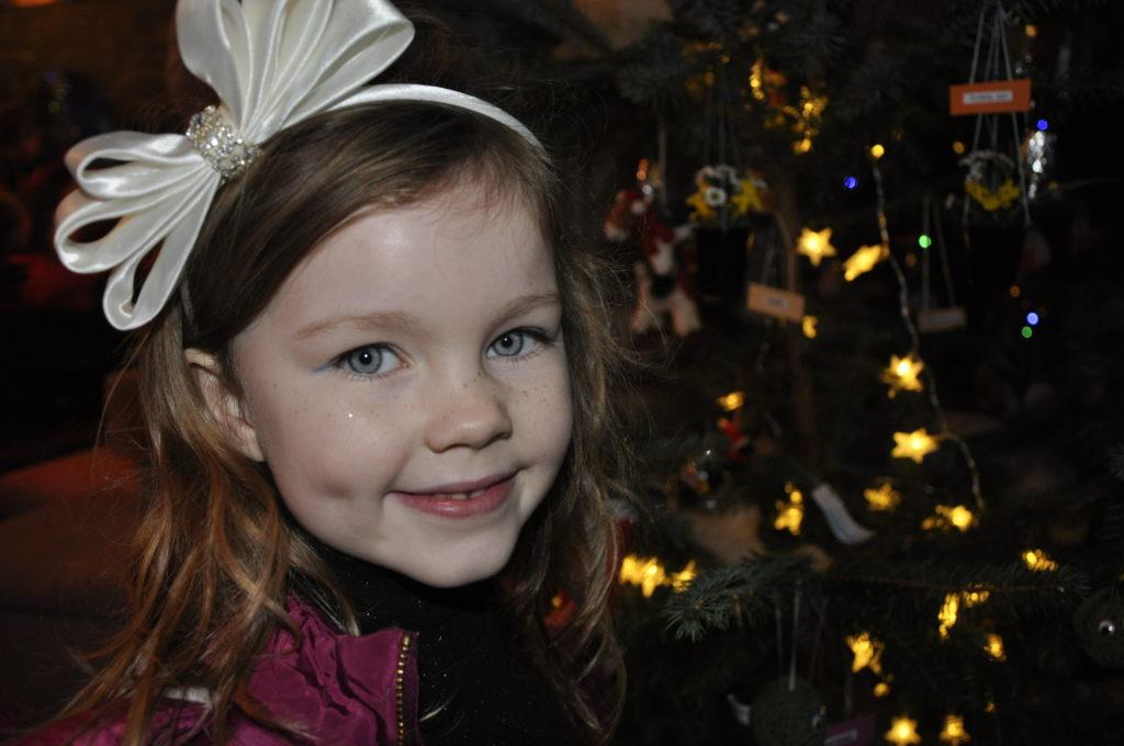 Ellie-Mae McKechnie, 5, enjoys the fairy lights at St Conan's Kirk Christmas Tree Festival.