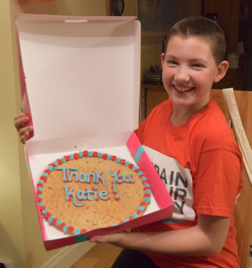 Katie with her special 'thank you' cookie from the Brain Tumour Charity.  NO F49 Katie Cookie