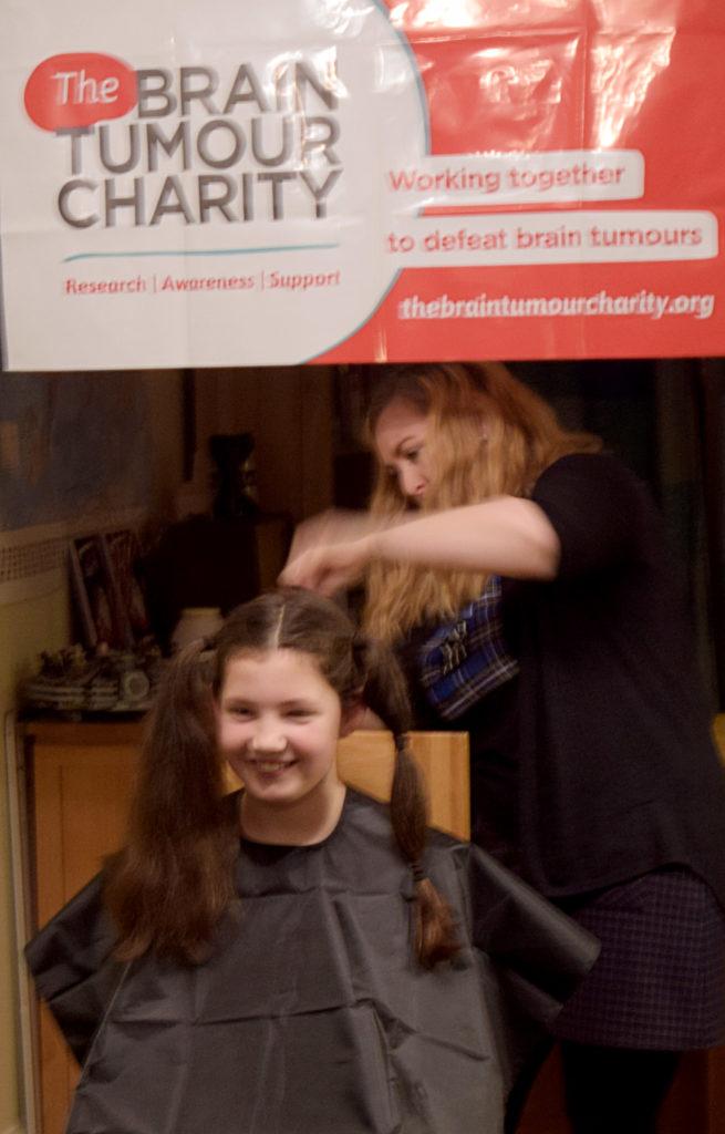Debbie Cox starts working cutting Katie's long hair.   NO F49 Katie cutting