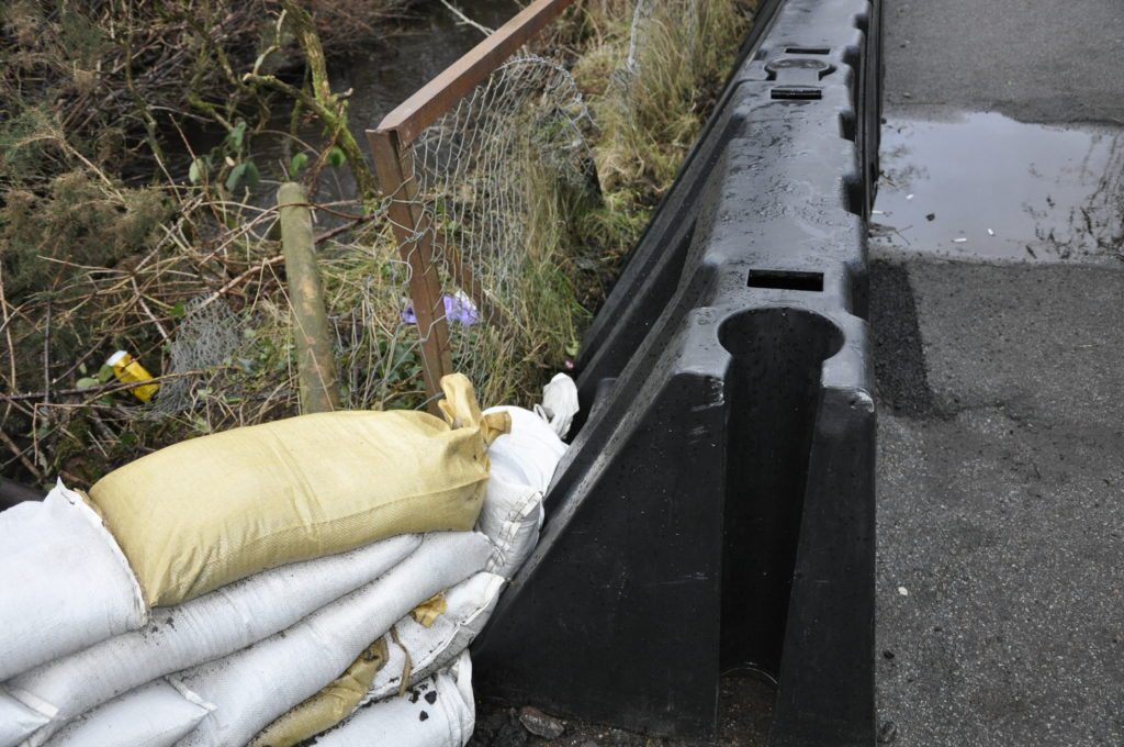 The height of sandbags was lower than the barrier before more were added on Tuesday.