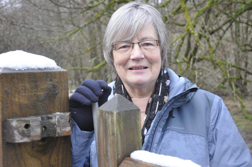 Janet Buchanan at the garden gate.