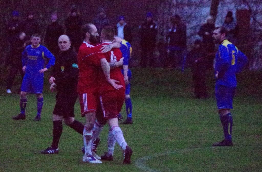 Jamie Graham congratulates Dene Cassells after his late equaliser.