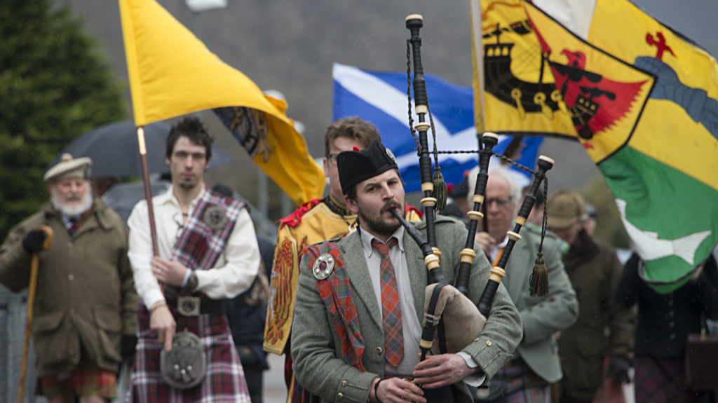 Iain MacGillivray, Commander of the Clan MacGillivray, ancient allies of the MacDonalds of Glencoe, pipes the procession from St Mary's Church along Glencoe main Street. PICTURE IAIN FERGUSON, THE WRITE IMAGE  NO F08 Glencoe massacre commemoration 01