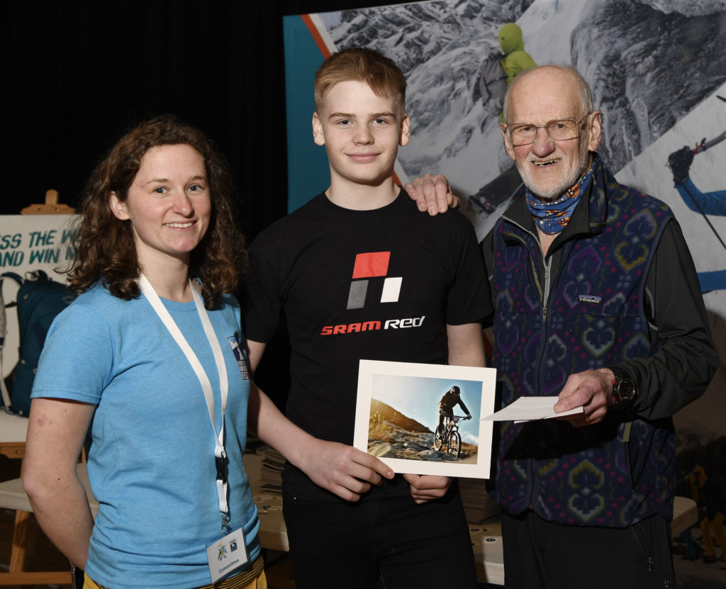 Winner of the Young Photographer of the Year competition,14-year-old Ruaraidh Johnson, received his trophy fromrenowned local outdoor photographer Alex Gillespie, and competition organiser, Hannah Francis.