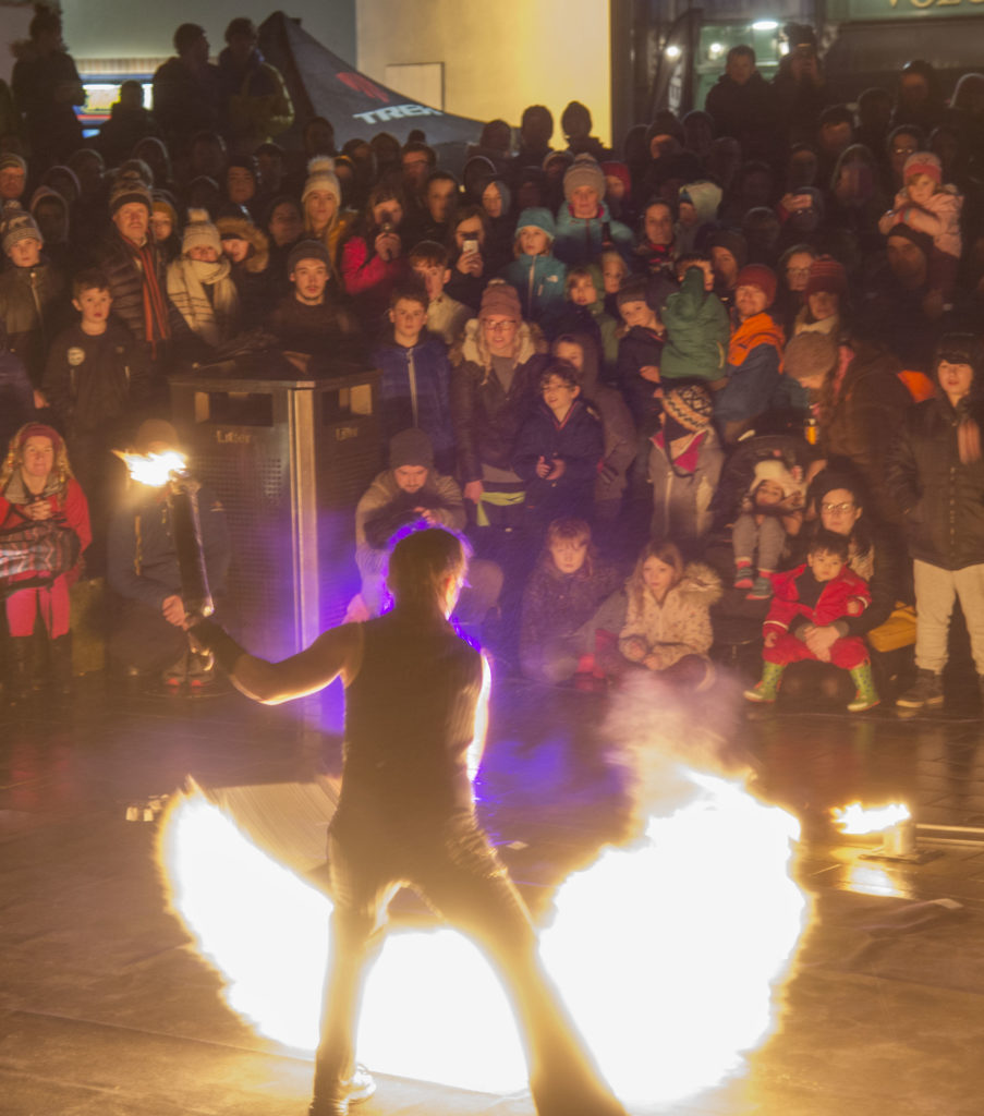 FlameOz's fiery performance at Cameron Square helped welcomehome the runners who took part in the torch lit hillside procession to open this year's festival.