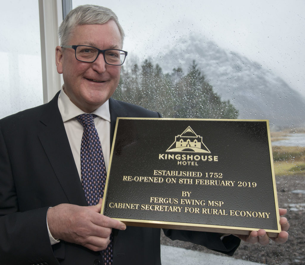 KINGSHOUSE OPENING 8/2/19  Fergus Ewing unveiled the plaque re-opening the new KIngshouse Hotel in Glencoe with the wet and windy Buachaille Etive Mor safely on the other side of the glass. PICTURE IAIN FERGUSON, THE WRITE IMAGE