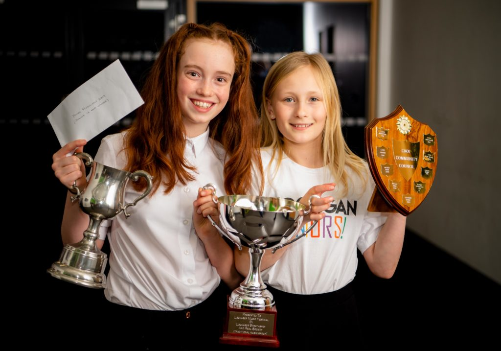 Trophy winners and friends Chloe Reynolds (left) and Lila Berardelli.