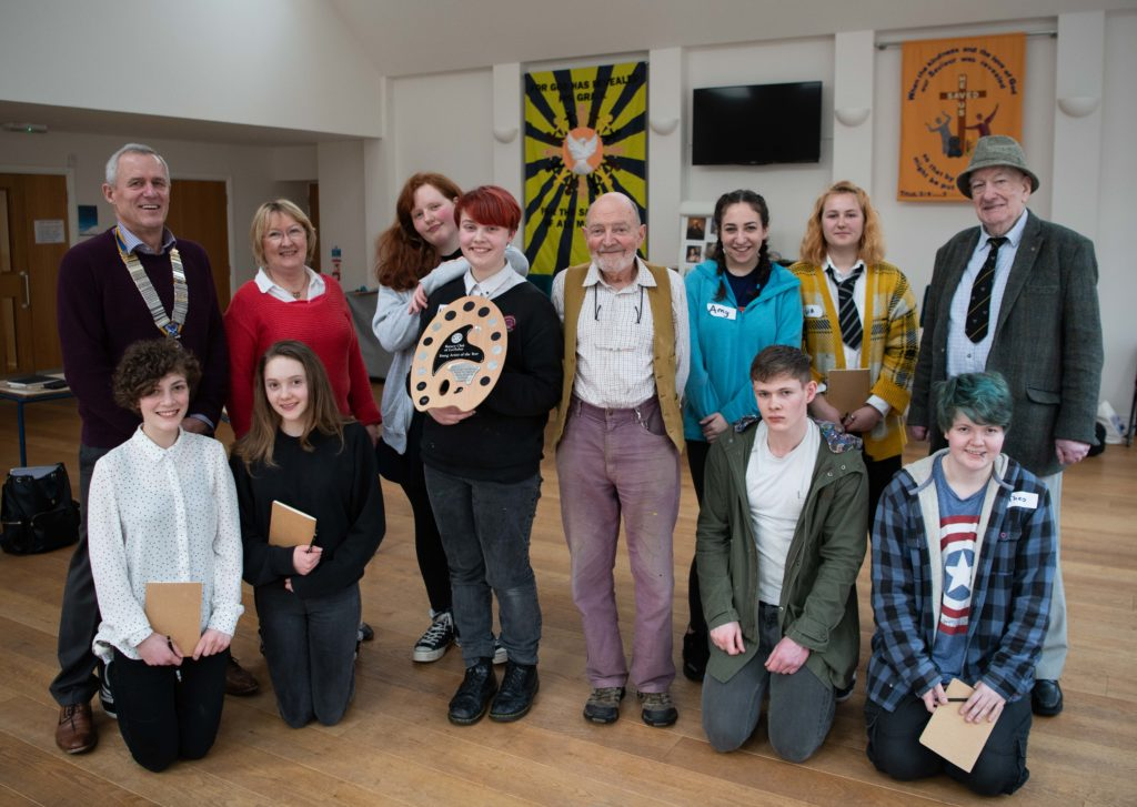 Competitors from local high schools with Rotary president Iain Johnston, youth activities convenor Margaret Boyd, artist Alastair Smyth and Rotarian Angus Nicholson.