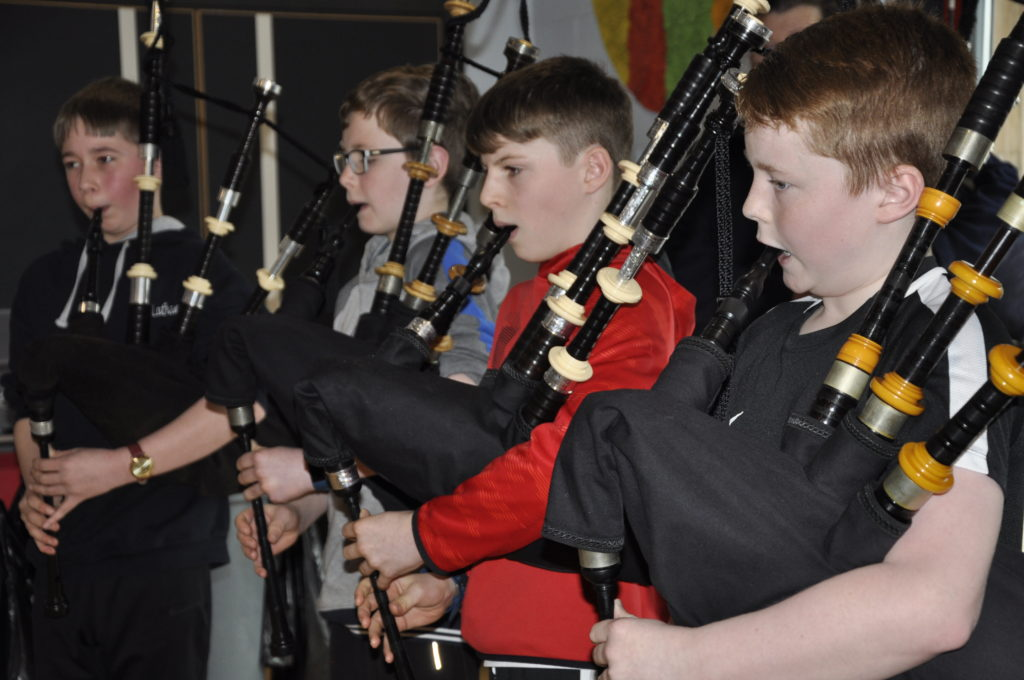 Young pipers performing.
