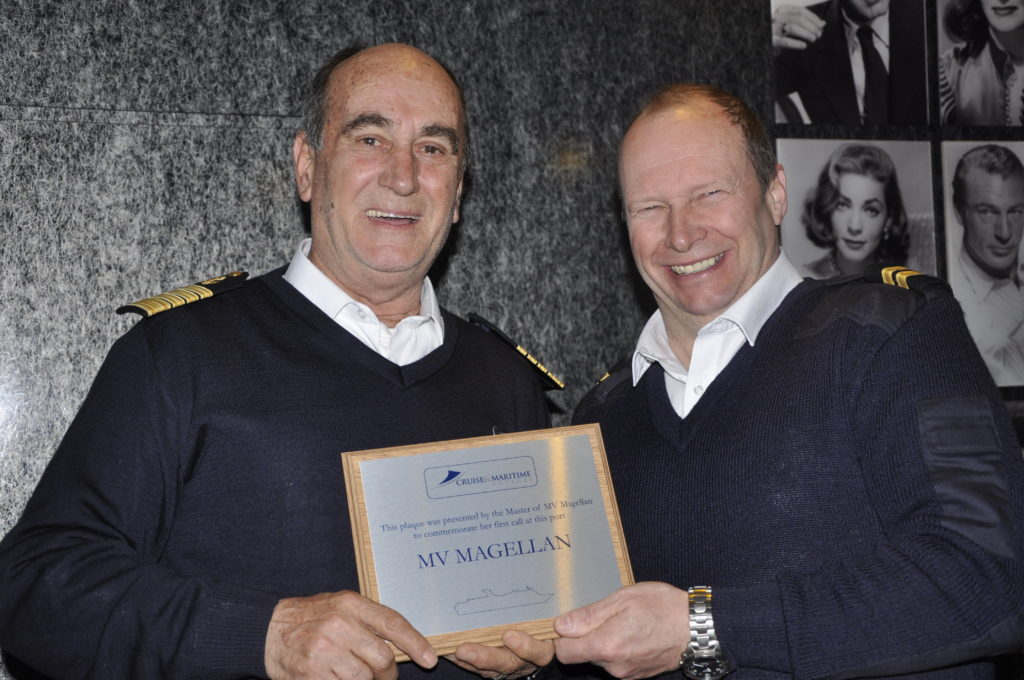 Captain Michail Margaritis hands over a commemorative plaque from the ship to Oban assistant harbour master Richard Dobson.