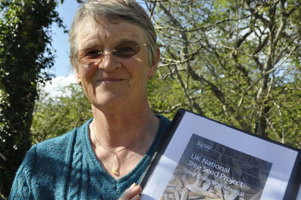 Ann Evans from Mull Native Woodlands Group with Kew Garden's seed bank manual.