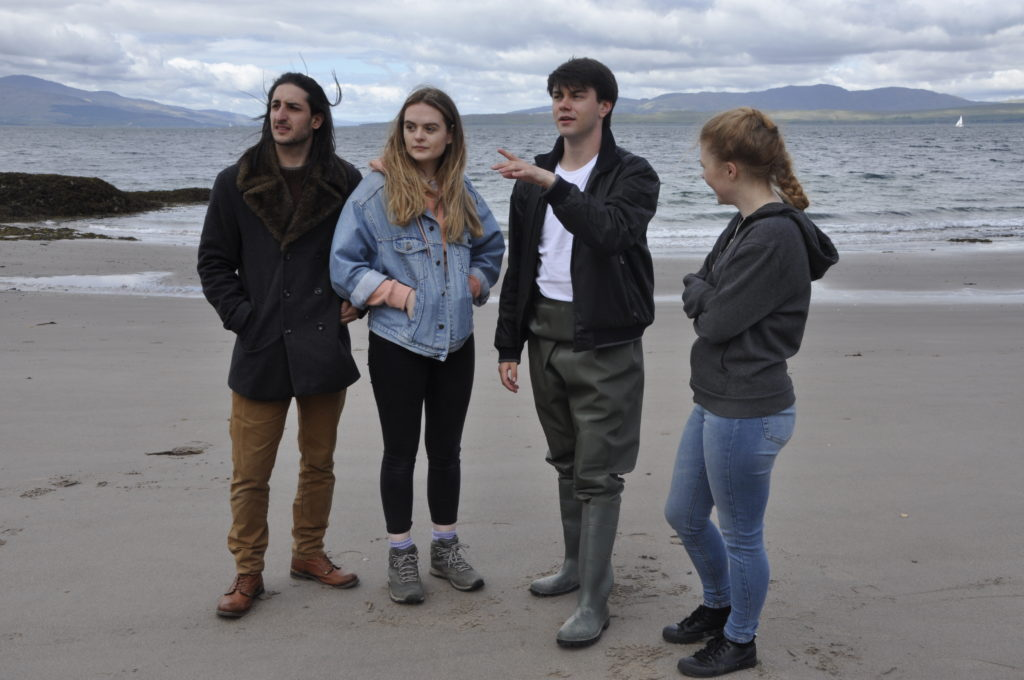 Taynuilt's James Kane directs the other actors, Niamh O'Donnell and Offir Limacher on his right and Chelsea Grace on his left.