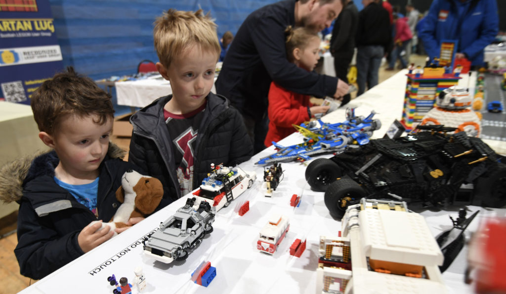 Robert (6) and Glen (3) Anderson fascinated by the world of Lego at one of the Tartan Lug exhibits. Picture Iain Ferguson, alba.photos  NO F19 Model show 04